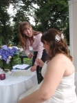 Amber Knapton of White Orchid Weddings helping a bride