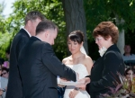Exchanging of the rings at a White Orchid Wedding ceremony