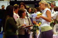 girl talking to brides and mom at the wedding shows